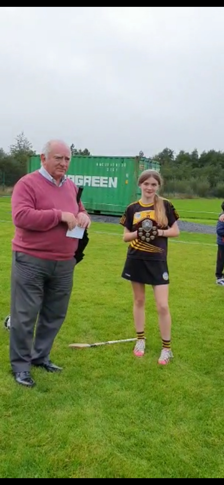 Clare Camogie Chairperson, Joe O'Donnell presents U13B Plate to the Ballyea team captain