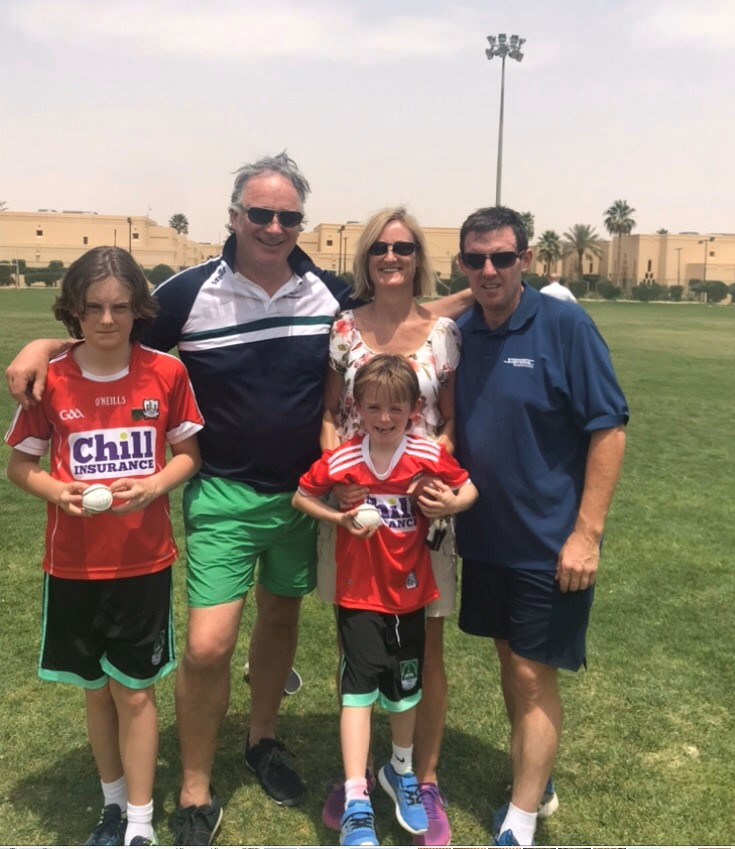 Tony with his wife Margaret and sons Darragh & Caolum with former Cork hurler Tomas Mulcahy in Riyadh