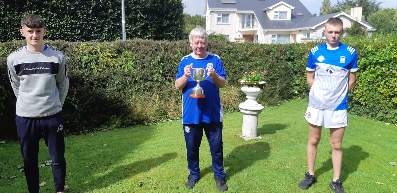 Club legend Billy Carroll gets to grips with the cup.