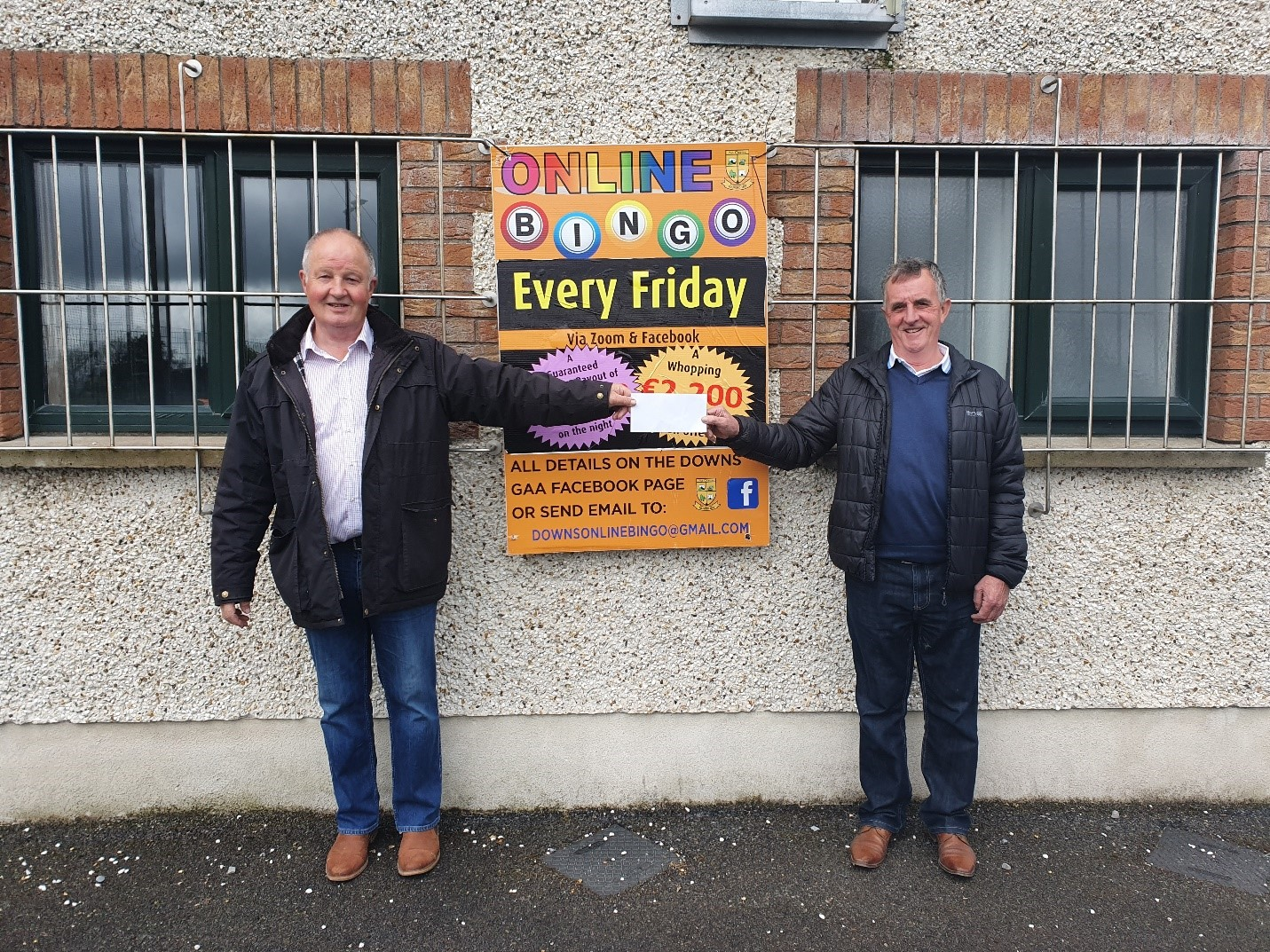 Pictured above is Thomas (Owen) Loran accepting the Jackpot winning prize from Aiden McGuire(The Downs GAA Chairman) for Friday 21st May