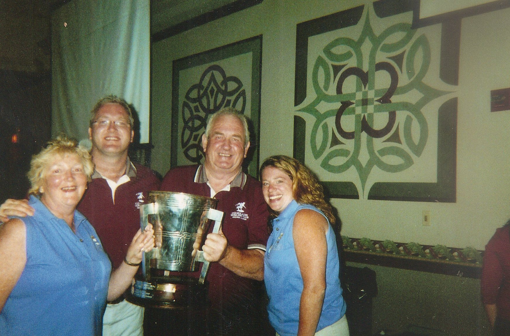 Colm with his mother Mary, father Jim and wife Michelle after the 2002 Chicago fina